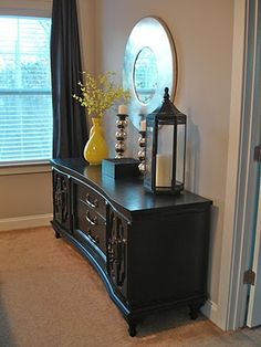 Old furniture painted black....this may work for my kitchen table and chairs... :)