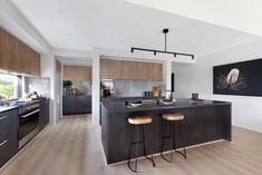The black artwork on the wall nicely complements the black units and island in an otherwise fairly neutral kitchen/ New Home Designs, Home Design Plans, Home Interior Design, Delta House, Finding A House, Kitchen Styling, Kitchen Remodel, House Plans, New Homes