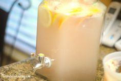 Sherbet Punch ~ 2 - 2 Liters of Diet Sierra Mist (You can use regular), 1 Tub of Rainbow Sherbet, Slices of Lemons, Grapefruits, and Oranges, Ice