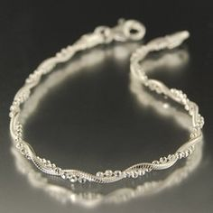 twisted, sterling silver, Italian chain 7 inch bracelet-- I had one of these as an anklet when I was in middle school!