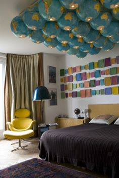 Intersting use of globes for light fixture and great color - Didier Krzentowski, Paris
