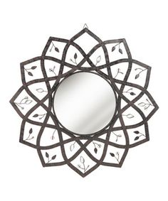 Turn an empty wall into a focal point with this dramatic lotus-shaped mirror. With a design and colors drawn from nature, this alluring contemporary piece brings serene sophistication to any room.