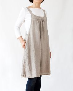 Item description This jump dress was made with medium-weight linen with in-seam side pockets in both sides. Just slip it over your head and it will nicely wrap around you with a loose fitting and a flattering A-line. Use it at home or to go out; it is very versatile and can be used as a dress or as an apron when you need coverage both in the front and back. Material 100% Medium-weight natural linen Linen is a natural fabric made of flax fibers and it is known for its durability and long…