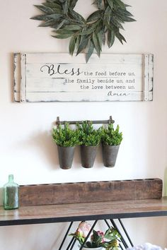 This classic prayer -- Bless the food before us the family beside us and the love between us Amen -- provides the perfect farmhouse backdrop for the dining room or kitchen! The wording -- with Bless and Amen emphasized in an cursive font -- is painted on a barn door style wood slat