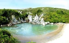 """""""hidden beach"""" like the Marieta, Mexico. It's in Asturias, in the north of Spain and its name is Gulpiyuri: Green Sand Beach, New Zealand Image, New Zealand Beach, Hidden Beach, Seaside Resort, Places To See, Atlanta, Around The Worlds, Adventure"""
