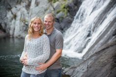 A couple standing in front of a waterfall. Copyright Photographics Solution 2012