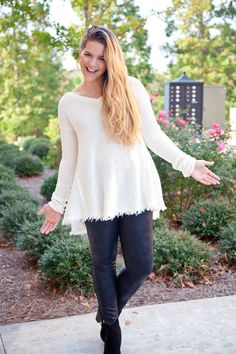 """Fringe is all over the place this season and you'll love the 'lil bit on this v-neck knit! Fits true to size. Sabrina is wearing a size Small/Medium. Her height is 5'7"""", bust 36"""", waist 30"""" hips 42""""."""
