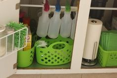 New Nostalgia – Under The Kitchen Sink Organization - I like the tension rod to hold the spray bottles.