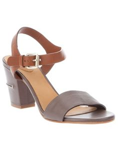 Grey leather sandal from Chloé featuring a contrasting brown buckle fastening ankle strap, a leather covered block heel with a contrasting white stitch detail and a leather sole.  £349.00