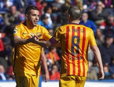 Jordi Alba of Barcelona celebrates scoring his team's first goal with his teammate Andres Iniesta during the La Liga match between Levante UD and FC Barcelona at Ciutat de Valencia on February 07, 2016 in Valencia