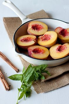 Here's something easy and so good -  Upside Down Peaches with Basil - Simmer 1 cup wine and 1 cup sugar in skillet until sugar dissolves.  Reduce heat, add 2 Tbs finely chopped Basil and a dash of Cinnamon, stir, add Peaches cut side DOWN and simmer until soft and heavenly delicious.  Took me about 10 minutes start to finish.  To serve these, I just made some regular Cinnamon Toast, and put two peaches on top with a little of the syrup from the skillet.  Yum.  My guests went crazy for this... Healthy Fruits, Healthy Eating Recipes, Fruits And Veggies, Healthy Cooking, Healthy Snacks, Vegetables, All You Need Is, No Sugar Diet, Mouth Watering Food