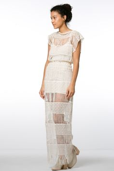 The most beautiful crochet dress we have ever seen. This ivory crochet maxi dress by Callahan is just oh so lovely. Wear it over a slip dress, swimsuit, or even a top and pants. Slip dress not included. material: 100% cotton measurements for size XS/S: waist: elastic waistband stretches comfortably to 26 in. length: 59 in. from shoulder to fringe