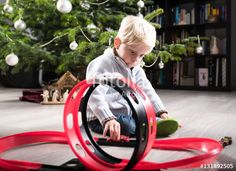 Boy playing with Christmas present