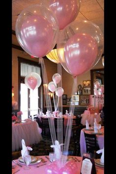 Pink balloons inside clear ones.