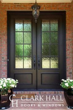 Custom iron front entry doors transform the design of any entrance. With large glass windows to let in all the natural light, these custom made traditional double doors take your exterior french door ideas to the next level. Double Front Entry Doors, Front Door Entryway, Iron Front Door, Exterior Front Doors, Patio Doors, Front French Doors, Front Door With Glass, Farmhouse Front Doors, Entry Doors With Glass