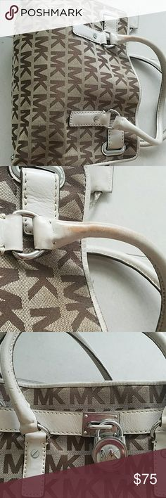 Michael Kors authentic monogram handbag Preserved well handbag, monogram light brown with brown letters. Minor defects due to wear in lower handles and one handle is slight deformed due to storage but probably with use will have formal again. Overall Google condition, comes in with large strap inside that can be hidden. Minor scratches at edges as shown. Michael Kors Bags