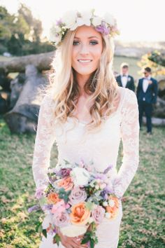 Gorgeous Bride wearing long sleeved lace gown and floral headpiece.