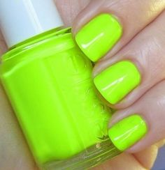 Essie Neon Green Nail polish and squared off short nails! i'm imagining my day-glo fingertips flying over the keyboard right now!