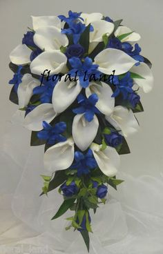 love this for a brides bouquet. I like the cascading bouquet with pops of blue.