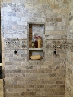 Claros Silver Travertine. Pretty color - maybe in Porcelain though instead? Built-in washcloth hooks are a great idea. What happens though if you want to replace them down the road?