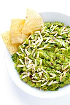 Austins TX taco and eats.This Toasted Almond and Chipotle Guacamole recipe is easy to make in about 10 minutes, and it's absolutely IRRESISTIBLE. Trust me. Chipotle Guacamole Recipe, Homemade Guacamole, Avocado Recipes, Chipotle Dip, Mexican Food Recipes, Vegetarian Recipes, Healthy Recipes, Ethnic Recipes, Dip Recipes