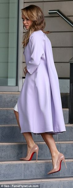 Amanda Holden in a lilac coat with nude Louboutin heels.
