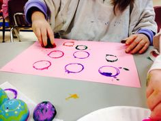 Painting with plastic easter egg halves!