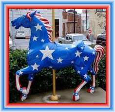 Patriotic Merry-Go-Round Carousel Horse decorated in blue with white stars as well as a red and white striped mane and tail