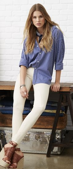 75bd465f0eb8 The Relaxed Classic Polo Ralph Lauren Women s Button Down Shirt  Crisp navy  and white stripes pair perfectly with cream pants.
