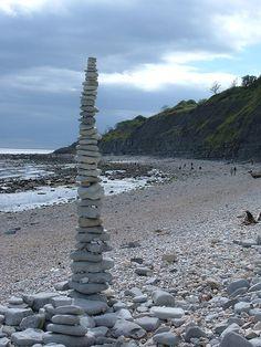 balanced on monmouth beach, lyme regis, uk