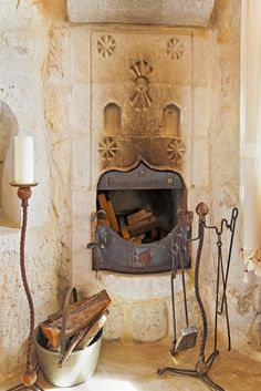 medieval castle styled luxury outdoor fireplace idea with seating