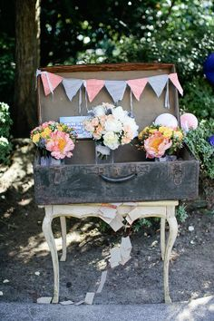 Suitcase at entry for cards and small presents  http://www.weddingchicks.com/2013/11/01/portland-backyard-wedding/