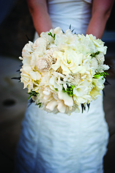 Ritz Wedding: The bride's bouquet included white feather tulips with hand-carved wooden peonies.