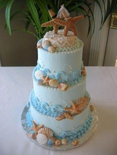 beach wedding cake with starfish topper