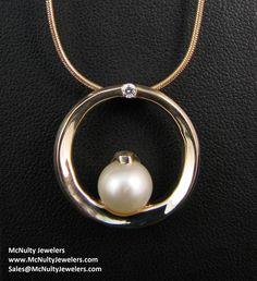 Simple and elegant! Yellow gold, pearl and diamond pendant.  McNulty Jewelers original design