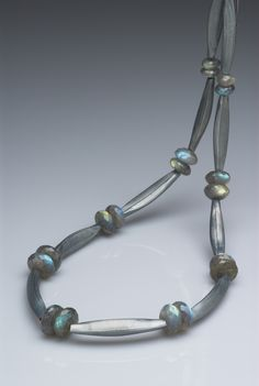 Jane Adam - necklace in oxidised fine silver and labradorites Length 550mm. Amazing how liquid and flowing the formed silver bead/links look