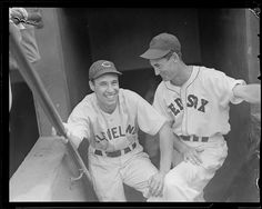 Cleveland Indian Bob Feller and Boston Red Sox Ted Williams in the dugout at Fenway Park.1940 - 1941 (approximate)