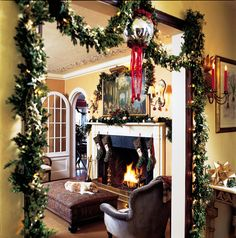 fireplace and mantle decorated for the holidays    A Canine Christmas  - Traditional Home®