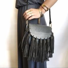 Grey Croc Embossed Tassel Saddle Bag Crossbody This luxe bag is the perfect shade of grey. Beautiful texture play with croc / reptile embossing, suede tassels, and gold d ring loops. Adjustable strap. Interior features a pocket under the flap for stashing easily accessible items and an interior zip pocket in the main compartment. Saddle bag shape makes main compartment roomier than expected, perfect for fitting all of your essentials. NWT. Also available in black. Vegan leather. Will not be…