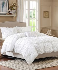 revamp your bedroom with this chic comforter set that flaunts intricately textured details and unobtrusive color for a style both accented and classy