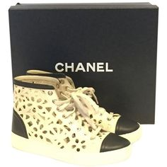 Pre-owned Chanel White Cut Out Flower High Top Sz 36 Sneakers Cream... ($559) ❤ liked on Polyvore featuring shoes, sneakers, cream and black, white high tops, black leather shoes, white high top sneakers, floral sneakers y black leather high tops