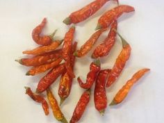 Burmese Amber Nectar Imported into China from Burma through the border towns in Yunnan province in small amounts, these small chillies have a rich orange colour with a translucent skin, are wonderfully. Similar in heat to bird's eye this is one spicy chilli you must try.