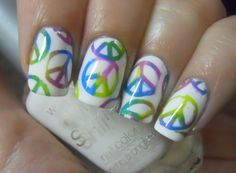 Nail peace paint the first coat multi colors, then peace sign cut out stickers, let dry, then put on 2nd coat and when all dry, peel off stickers.