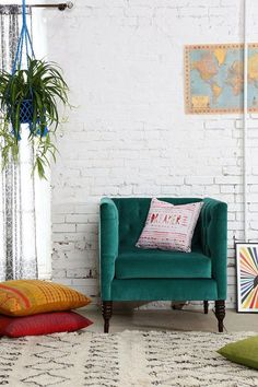 Such a perfect little corner. We love the combination of the velvet chair, floor pillows and velvet chair.
