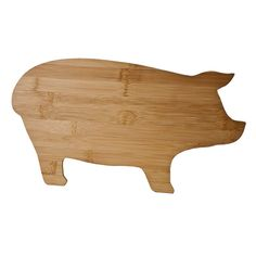 pig-shaped cutting board. would be hilarious to serve up some cheese and charcuterie on this bad boy.