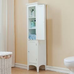 @Overstock.com - Bayfield White 2-door Linen Tower - This tall white linen tower provides an attractive way to store towels and supplies neatly. The two shutter-style doors and the crown-molded top accent this piece with a modern and sophisticated style, and the door magnet is easy to open and close.  http://www.overstock.com/Home-Garden/Bayfield-White-2-door-Linen-Tower/8162284/product.html?CID=214117 $164.99