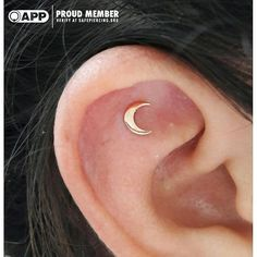 Adorable Fresh Ear Piercing with a Rose Gold Moon