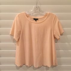topshop peach scallop hem tee♡ peachy scallop hem tee from topshop. the color is pinker in person. besides a tiny grey stain on the back which can probably be removed, it's in perfect condition. I bought it but never wore it which is why I am selling it. the material slightly see-through but not bad at all. it is an American size 6, which is equivalent to a medium. free gift with purchase Topshop Tops Tees - Short Sleeve