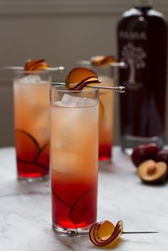 How to make a gorgeous cocktail or mocktail garnish with thin slices of fresh plum turned into petals | Party Drinks | #cocktails #mojitos #drinks #partydrinks | www.thannuongrestaurant.com.au