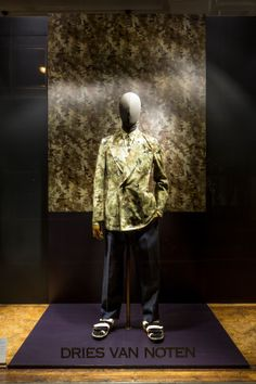 camouflage: fabric or a garment dyed in splotches so as to make the wearer indistinguishable from the surrounding environment, pinned by Ton van der Veer